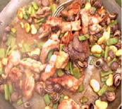 azafrán paella con caracoles